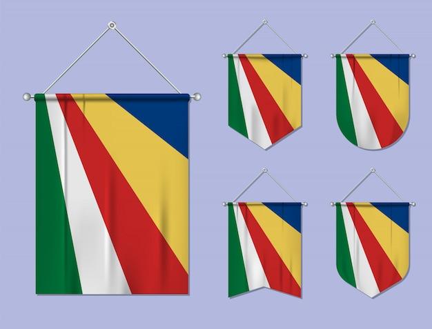 Zestaw wiszących flag seszele z tekstylną teksturą. różnorodność kształtów kraju bandery. proporczyk pionowy szablon.