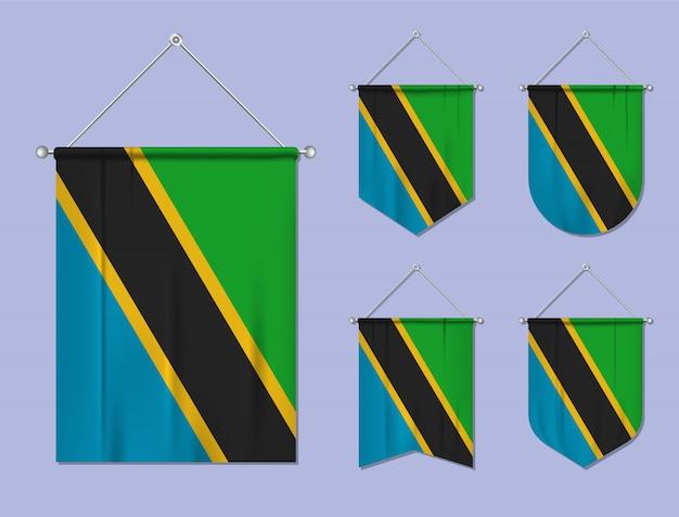 Zestaw wiszących flag tanzanii z tekstylną teksturą. różnorodność kształtów kraju bandery. proporczyk pionowy szablon.