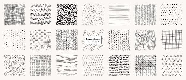 Zestaw wzorów wyciągnąć rękę na białym tle. tekstury wykonane tuszem, ołówkiem, pędzlem. geometryczne kształty bazgroły plam, kropek, okręgów, kresek, pasków, linii.