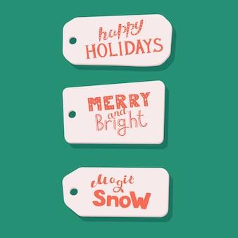 Zestaw z fraz wakacyjnych na kartach izolowanych na fioletowym tle szczęśliwego nowego roku wesołych świąt