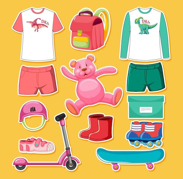 Zestaw zabawek i ubrań w kolorze różowym i zielonym na białym tle