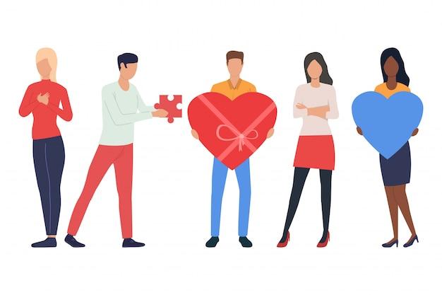 Zestaw zakochanych młodych ludzi. mężczyźni i kobiety trzymające serca