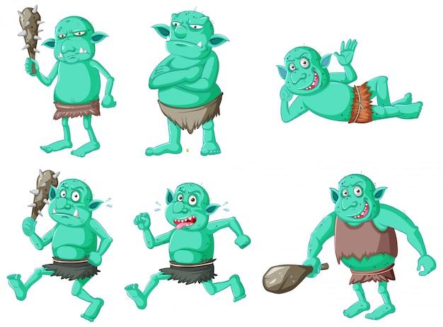 Zestaw zielony goblin lub troll w różnych pozach w postać z kreskówki na białym tle