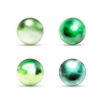 Zestaw zielonych błyszczących marmurowych kulek z odblaskiem na białym tle