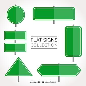Zestaw zielonych znaków drogowych w płaskim stylu
