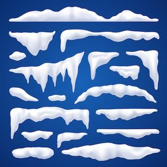 Zestaw zimowy peleryny i stosy śniegu