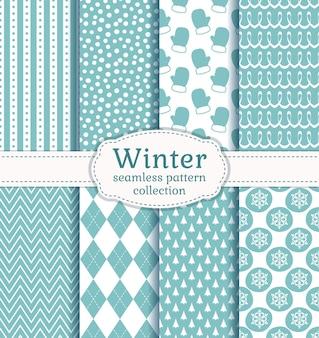 Zestaw zimowych bez szwu wzorów w jasnoniebieskich i białych kolorach.