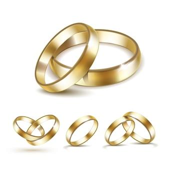 Zestaw złote obrączki ślubne na białym tle
