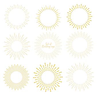 Zestaw złoty styl sunburst na białym tle.