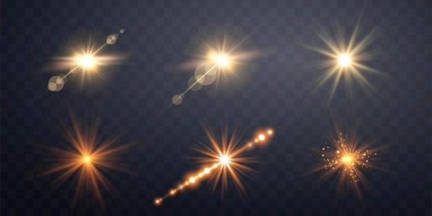 Zestaw złotych flar. na przezroczystym tle. błysk słońca z promieniami lub złotym reflektorem i bokeh.