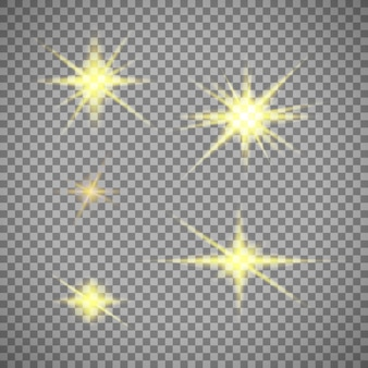 Zestaw złotych gwiazd światła na przezroczystym tle