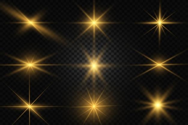 Zestaw złotych jasnych pięknych gwiazd. efekt świetlny bright star. piękne światło do ilustracji, białe iskry błyszczą specjalnym światłem. wektor błyszczy