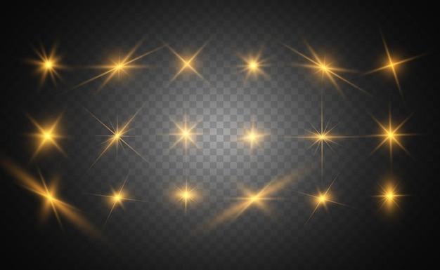 Zestaw złotych jasnych pięknych gwiazd. efekt świetlny bright star.