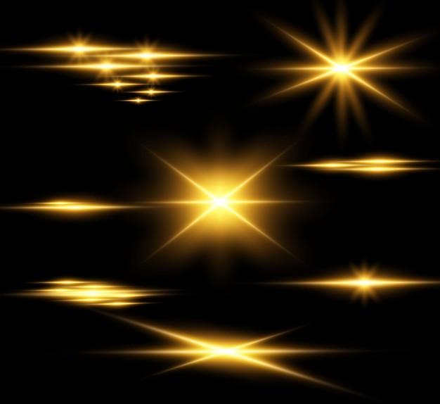 Zestaw złotych jasnych pięknych gwiazd efekt świetlny jasna gwiazda piękne światło do ilustracji