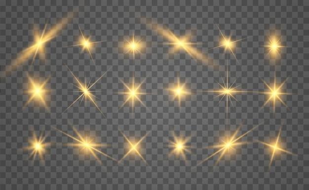 Zestaw złotych jasnych pięknych gwiazd