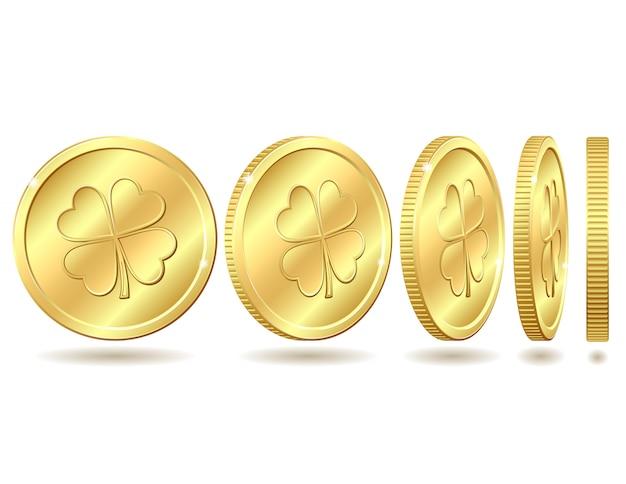 Zestaw złotych monet z czterolistną koniczyną.