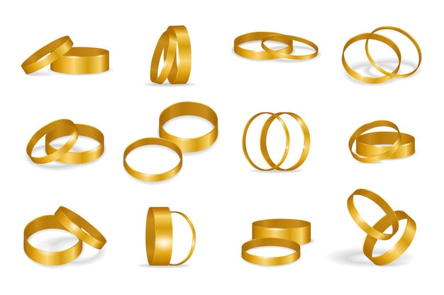 Zestaw złotych obrączek ślubnych na białym tle
