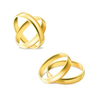 Zestaw złotych pierścionków zaręczynowych na białym tle