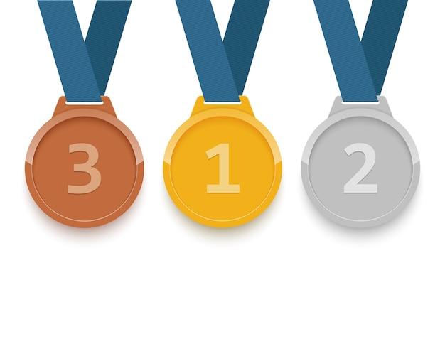 Zestaw złotych, srebrnych i brązowych medali na białym tle