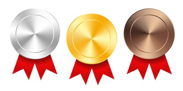 Zestaw złotych, srebrnych i brązowych medali z czerwonymi wstążkami. medal okrągły kolekcja pusty wektor polerowany na białym tle. odznaki premium.