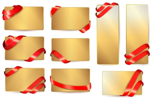 Zestaw złotych wizytówek z czerwonymi wstążkami