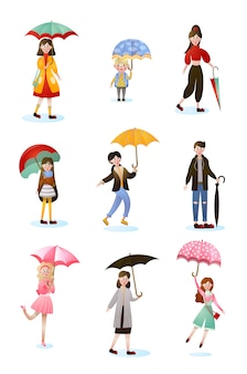 Zestaw znaków uśmiechniętych ludzi w różnym wieku z parasolami
