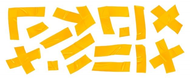 Zestaw żółtej taśmy klejącej.
