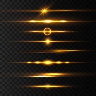 Zestaw żółtych flar z poziomymi soczewkami, wiązki laserowe, rozbłysk światła. promienie światła linia blasku jasny złoty blask na przezroczystym tle świecące smugi. świetliste abstrakcyjne musujące linie. ilustracja