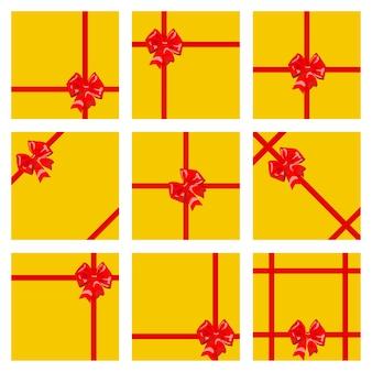 Zestaw żółtych pudełek na prezenty, przewiązanych czerwonymi wstążkami i kokardkami. widok z góry. płaska konstrukcja