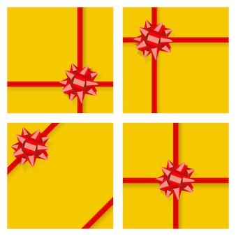 Zestaw żółtych pudełek na prezenty, przewiązanych czerwonymi wstążkami i kokardkami, z cieniami. widok z góry. płaska konstrukcja
