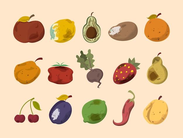 Zgniłe warzywa i owoce na białym tle. odbiór odpadów spożywczych
