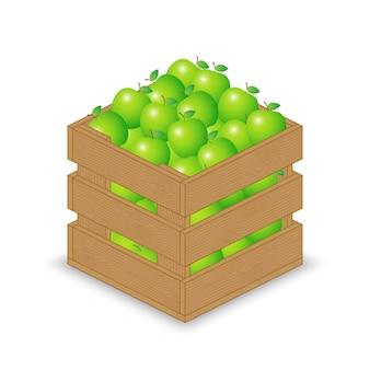 Zielone jabłko w drewnianej skrzyni