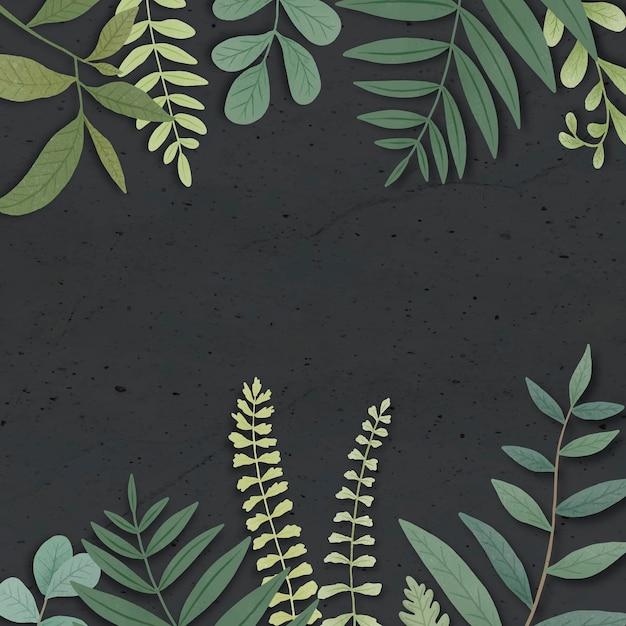 Zielone liście graniczą na czarnym tle