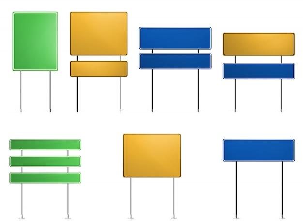 Zielone, niebieskie, żółte znaki drogowe.