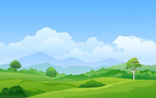 Zielone pastwisko z górami i drzewami