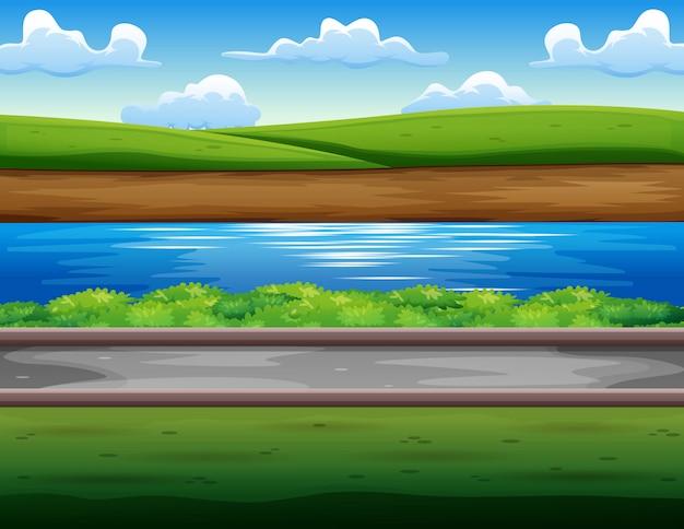 Zielone pole nad brzegiem rzeki