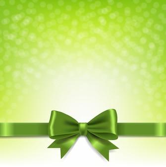 Zielone tło bokeh z kokardą