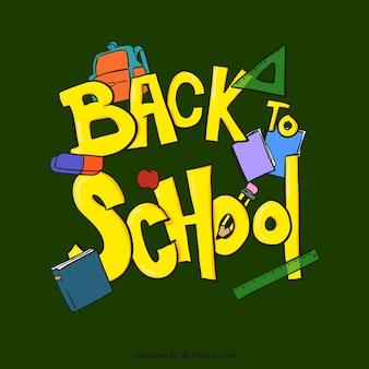 Zielone tło z przyborów szkolnych na powrót do szkoły