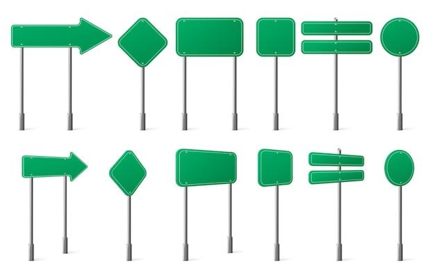 Zielone znaki drogowe o różnych kształtach na metalowym słupku z przodu i pod kątem