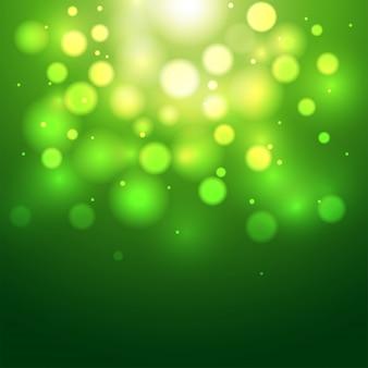 Zielony defocused bokeh abstrakta tło.