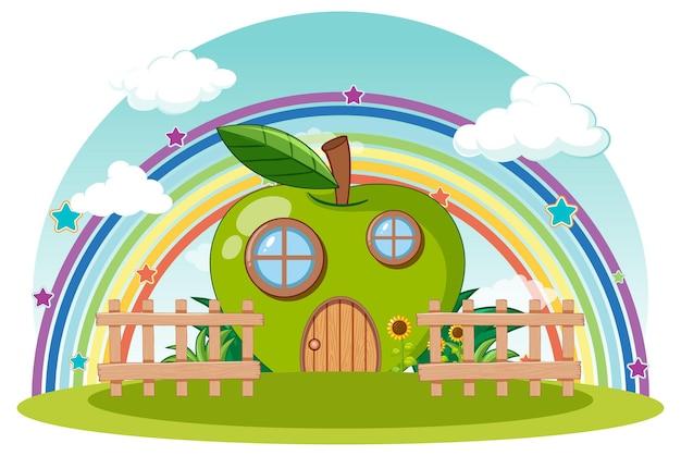 Zielony domek z jabłkami i tęczą na niebie