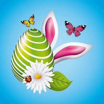 Zielony duży jajko easter ucho królika motyl i biedronka