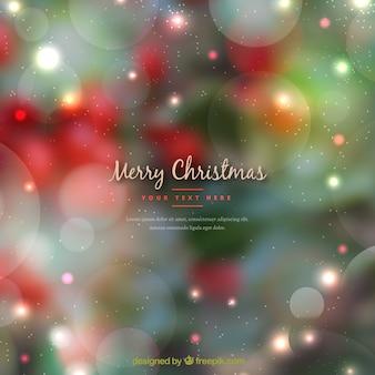 Zielony i czerwony rozmyte tło Boże Narodzenie