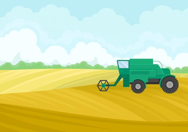 Zielony kombajn na polu. widok z boku.