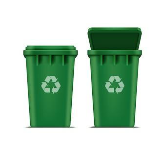 Zielony kosz na śmieci i śmieci na białym tle