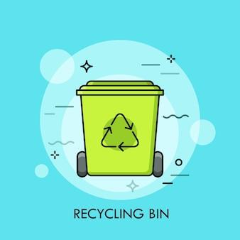 Zielony kosz na śmieci lub pojemnik na śmieci.