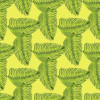 Zielony paproć geometryczny styl botanika wzór. żółte pastelowe tło. hawaje naturalny ornament.