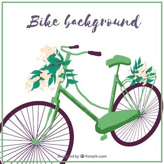 Zielony rower tle z kwiatowym dekoracji