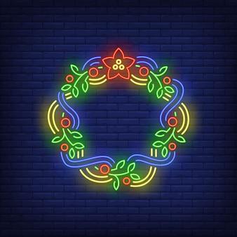 Zielony świąteczny wieniec z niebiesko-żółtymi wstążkami w neonowym stylu