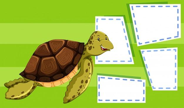 Zielony żółw na szablonie notatki